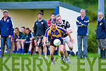Kenmare's captain Mark Crowley leads by example as he goes past Ardferts Darren Wallace to launch another attack.