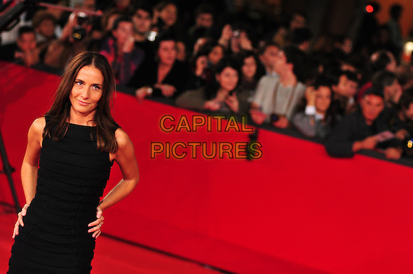 "MARIA SOLE TOGNAZZI, director.Red carpet arrivals for the premiere of ""L'Uomo Che Ama"" during the 3rd Rome International Film Festival, Rome, Italy..October 23rd, 2008.half length black dress hands on hips .CAP/CAV.©Luca Cavallari/Capital Pictures."
