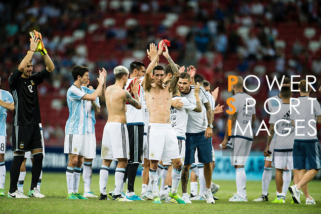 Angel Di Maria of Argentina (C) shirtless celebrating after winning the match during the International Test match between Argentina and Singapore at National Stadium on June 13, 2017 in Singapore. Photo by Marcio Rodrigo Machado / Power Sport Images