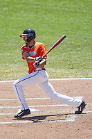 Virginia Cavaliers shortstop Daniel Pinero (22) follows through on his swing against the Florida Gators in Game 11 of the NCAA College World Series on June 19, 2015 at TD Ameritrade Park in Omaha, Nebraska. The Gators defeated Virginia 10-5. (Andrew Woolley/Four Seam Images)