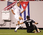 11 March 2008: Charlie Davies (USA) (9) leaps over the tackle from goalkeeper Jose Manuel Miranda (CUB) (1). The United States U-23 Men's National Team tied the Cuba U-23 Men's National Team 1-1 at Raymond James Stadium in Tampa, FL in a Group A game during the 2008 CONCACAF's Men's Olympic Qualifying Tournament.
