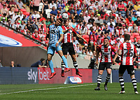 28th May 2018, Wembley Stadium, London, England;  EFL League 2 football, playoff final, Coventry City versus Exeter City; Maxime Biamou of Coventry City and Jordan Tillson of Exeter City jump to compete for the header
