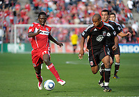 Chicago Fire forward Patrick Nyarko (14) dribbles down the field with DC United defender Julius James (2) in pursuit.  The Chicago Fire tied DC United 0-0 at Toyota Park in Bridgeview, IL on Oct. 16, 2010.