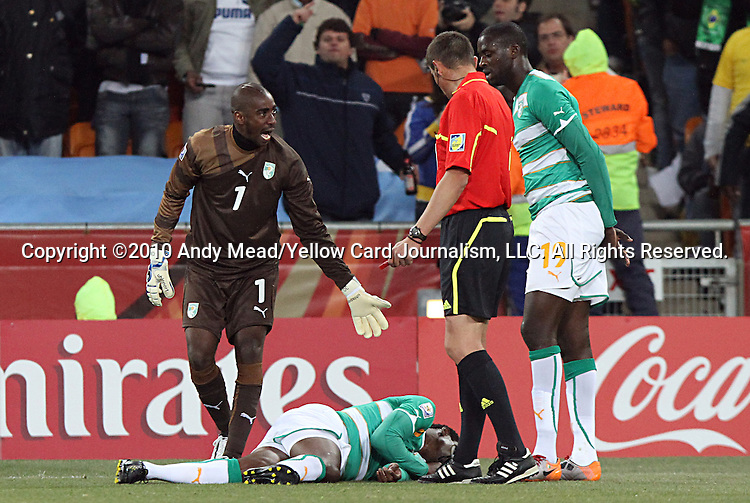 20 JUN 2010:  Boubacar Barry (CIV)(1) complains to Referee Stephane Lannoy (FRA) after his teammate is fouled.  The Brazil National Team defeated the C'ote d'Ivoire National Team 3-1 at the end of the first half at Soccer City Stadium in Johannesburg, South Africa in a 2010 FIFA World Cup Group G match.