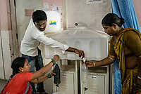 Patients and the family members fill iJal water provided by the hospital at the Medak District Hospital in Medak, Telangana, India.