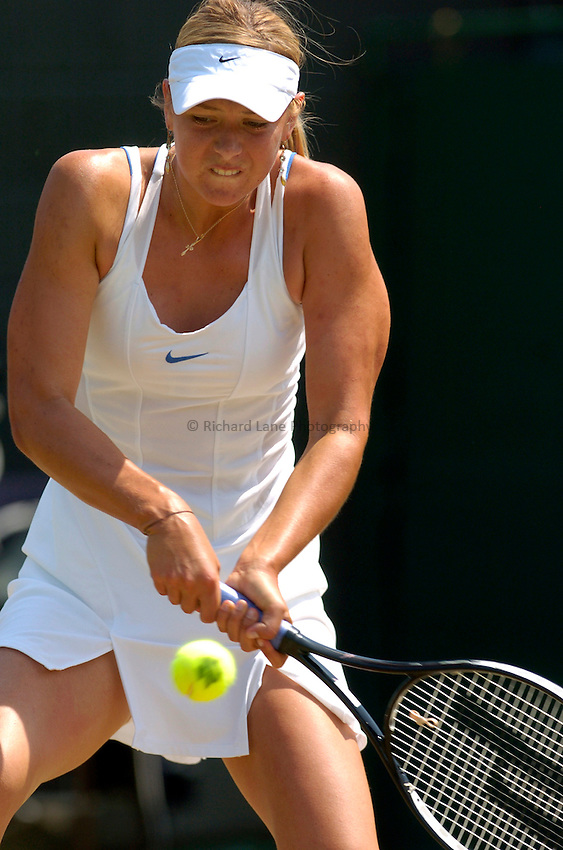Photo: Richard Lane..Wimbledon Championships. 03/07/2006. .Maria Sharapova of Russia returns.