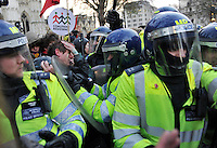Police and protestors clash during a student demonstration in Westminster, central London on the day the government passed a bill to increase university tuition fees.