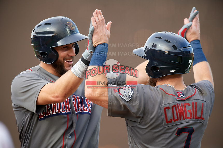 Lehigh Valley IronPigs designated hitter Trevor Plouffe (19) is congratulated by Collin Cowgill (7) after hitting a home run in the bottom of the third inning during a game against the Rochester Red Wings on June 30, 2018 at Frontier Field in Rochester, New York.  Lehigh Valley defeated Rochester 6-2.  (Mike Janes/Four Seam Images)