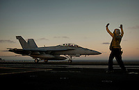 111217-N-DR144-187 PACIFIC OCEAN (Dec. 16, 2011)  Aviation Boatswain's Mate (Handling) 3rd Class Tilford Breedlove signals to the pilot of an F/A-18F Super Hornet assigned to Strike Fighter Squadron (VFA) 22 as it comes to a stop in the landing area after an arrested landing on the flight deck aboard Nimitz-class aircraft carrier USS Carl Vinson (CVN 70). Carl Vinson and Carrier Air Wing (CVW) 17 are currently underway on a Western Pacific deployment.  (U.S. Navy photo by Mass Communication Specialist 2nd Class James R. Evans/Released)
