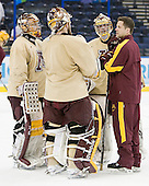 Justin Johnson (Minnesota - Volunteer Assistant Coach) addresses his goalies. - The University of Minnesota Golden Gophers practiced on Wednesday, April 4, 2012, during the 2012 Frozen Four at the Tampa Bay Times Forum in Tampa, Florida.