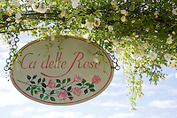 Detail of the sign at the entrance of the Ca' delle Rose specialist rose garden in Italy