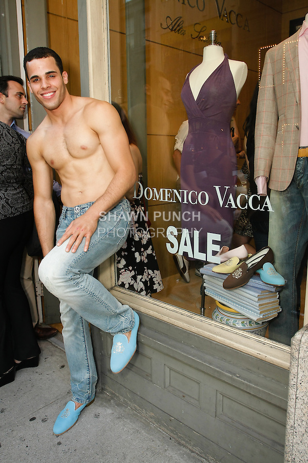 Model poses in St. Barths Jeans at the entrance to the Domenico Vacca Denim Launch Party presented by Models International on July 14, 2010.