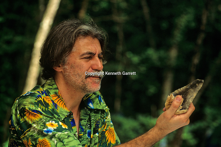 Jean-Michel Geneste, archaeologist, holds a Neandertal hand ax