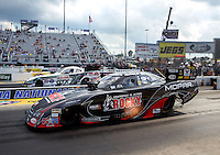 Sep 15, 2013; Charlotte, NC, USA; NHRA funny car driver Matt Hagan (near lane) races alongside John Force during the Carolina Nationals at zMax Dragway. Mandatory Credit: Mark J. Rebilas-