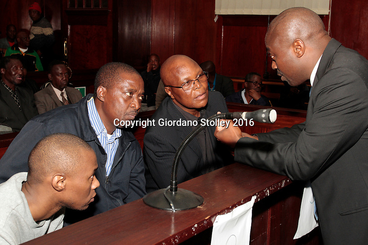DURBAN - 20 May 2016 - Lawyer Bulelani Mazomba (right) speaks to his clients before they are sentenced to life imprisonment in the Durban High Court for the murder of Abahlali baseMjondolo activist Thulisile Maureen Ndlovu. From the left facing Mazomba are gunman Mlungisi Ndlovu and eThekwini Metro Municipal  councillors Mduduzi Ngcobo (center) and Velile Lutsheko (right). They were convicted Thulisile Maureen Ndlovu's murder and sentenced to life imprisonment. The two councillors from the African National Congress wanted her dead because she opposed their programme of allocating houses to people who were not resident in the Thkoza area of the KwaNdengezi near Pinetown. Picture: Allied Picture Press/APP
