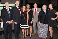 NWA Democrat-Gazette/CARIN SCHOPPMEYER Bob Hill (from left), Tommy Harris, Cindy McAfee Jerre and Terry Irwin, Rebecca McAfee; and Kristen Pittman attend the Sports Hall of Honor dinner in memory of Hal McAfee, a 2019 inductee.