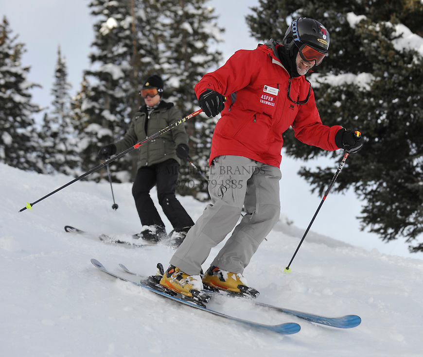 Instructor Alan Bush leads the way down Sunrise/Sunset on Aspen Moutain. Laura Davidson, 57, of Bear Valley, CA follows. Michael Brands for The New York Times.