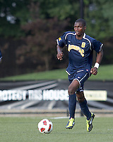 Quinnipiac University forward Machel Baker (8) brings the ball forward. Boston College defeated Quinnipiac, 5-0, at Newton Soccer Field, September 1, 2011.