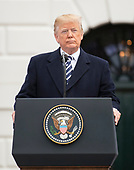 United States President Donald J. Trump makes remarks as he and first lady Melania Trump host an arrival ceremony for President Emmanuel Macron of France and his wife, Brigitte Macron, on the South Lawn of the White House in Washington, DC on Tuesday, April 24, 2018.<br /> Credit: Ron Sachs / CNP