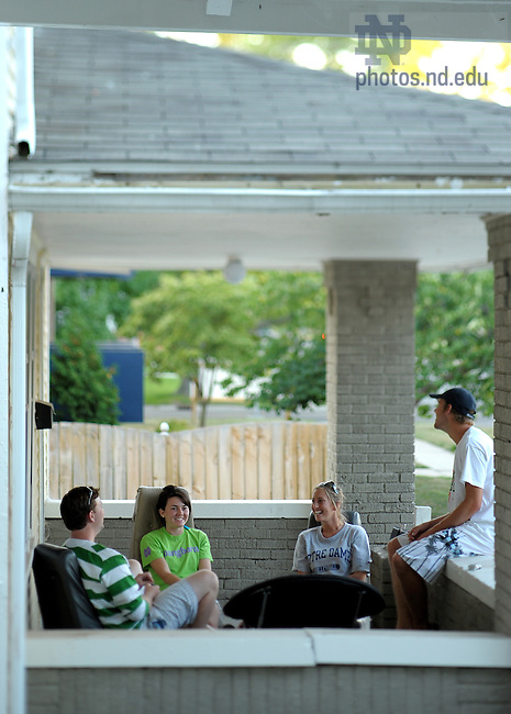 Undergraduates on the porch of their Notre Dame Avenue home, August 2008...Photo by Matt Cashore/University of Notre Dame