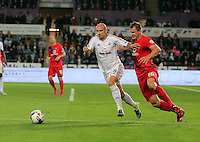 Pictured L-R: Jonjo Shelvey of Swansea against Dave Winfield of York  Tuesday 25 August 2015<br /> Re: Capital One Cup, Round Two, Swansea City v York City at the Liberty Stadium, Swansea, UK.