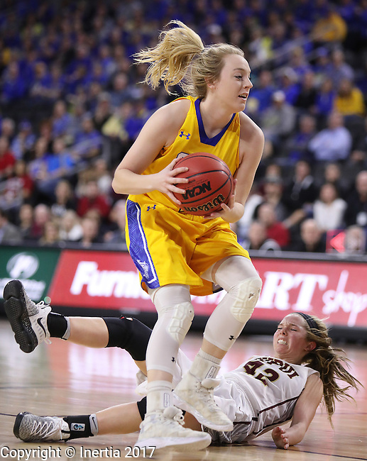 SIOUX FALLS, SD: MARCH 6: Madison Guebert #11 of South Dakota State drives past Sydney Hall #42 of IUPUI during the Summit League Basketball Championship on March 6, 2017 at the Denny Sanford Premier Center in Sioux Falls, SD. (Photo by Dick Carlson/Inertia)