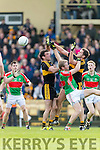 Ambrose O'Donovan and Eoin Brosnan Dr Crokes in Action against Noel McGrath Loughmore-Castleiney in the Munster Senior Club Semi-Final at Crokes Ground, Lewis Road on Sunday