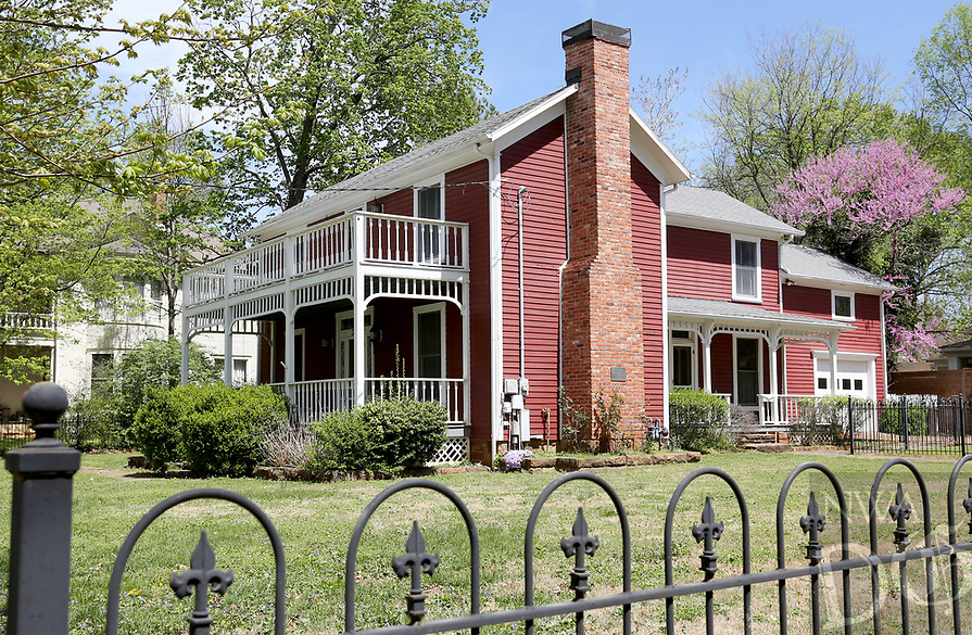 NWA Democrat-Gazette/DAVID GOTTSCHALK The Wade-Heerwagen House at 338 N. Washington Avenue is visible Friday, April 12, 2019, in the Washington-Willow district in Fayetteville. The city's Historic District Commission is working with a consultant on a draft of a preservation ordinance for the Washington-Willow Historic District. The ordinance would outline certain design standards to preserve the architectural character of the neighborhood while accommodating additions and modifications to existing homes and new developments.