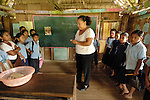 Second grade school teacher conducts class in Midway Village in Southern Belize.<br />