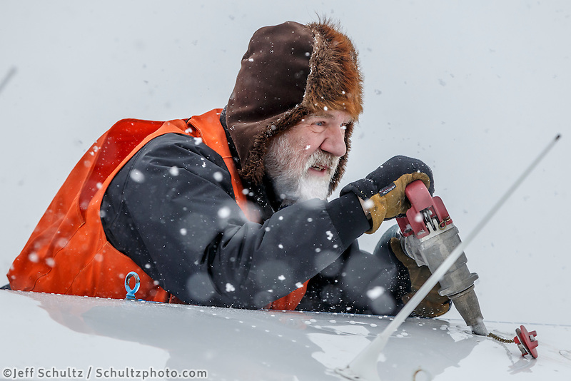 Volunteer pilot Greg Fischer fuels his plane during a snowfall at the Unalakleet checkpoint on Monday March 16, 2015 during Iditarod 2015.  <br /> <br /> (C) Jeff Schultz/SchultzPhoto.com - ALL RIGHTS RESERVED<br />  DUPLICATION  PROHIBITED  WITHOUT  PERMISSION