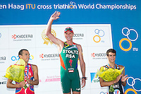 13 JUL 2013 - DEN HAAG, NED - Conrad Stoltz (RSA) (centre) of South Africa celebrates  winning the 2013 ITU Elite Men's Cross Triathlon World Championships in Kijkduin, Den Haag (The Hague), the Netherlands, flanked by silver medalist Ruben Ruzafa (ESP) (left) of Spain and bronze medalist Brice Daubord (FRA) (right) of France (PHOTO COPYRIGHT © 2013 NIGEL FARROW, ALL RIGHTS RESERVED)