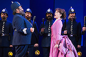 """London, UK. 7 May 2015. Jonathan Lemalu as Police Sergeant and Claudia Boyle as Mabel. Dress rehearsal of the Gilbert and Sullivan comic opera """"The Pirates of Penzance"""" at the London Coliseum. Award winning director Mike Leigh makes his operatic directing debut with The Pirates of Penzance. The ENO production opens at the London Coliseum on 9 May 2015 and runs for 14 productions until 27 June 2015. The English National Opera production is conducted by David Parry. Cast: Andrew Shore as Major-General Stanley, Joshua Bloom as The Pirate King, Alexander Robin Baker as Samuel, Robert Murray as Frederic, the Pirate Apprentice, Jonathan Lemalu as Sergeant of the Police, Claudia Boyle as Mabel, Soraya Mafi as Edith, Angharad Lyddon as Kate, Lydia Marchione as Isabel and Rebecca de Pont Davies as Ruth. Photo: Bettina Strenske"""