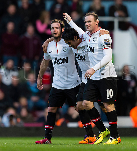 22.03.2014  London, England.  Manchester United's Wayne ROONEY celebrates scoring his second goal with team matesduring the Premier League game between West Ham United and Manchester United from the Boleyn Ground, Upton Park .