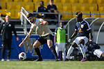 Jon Bakero (7) of the Wake Forest Demon Deacons keeps the ball away from Edward Opoku (11) of the Virginia Cavaliers during the 2017 ACC Men's Soccer Championship at MUSC Health Stadium on November 12, 2017 in Charleston, South Carolina. The Demon Deacons defeated the Cavaliers 3-2 in penalty kicks to win their second consecutive ACC Championship.  (Brian Westerholt/Sports On Film)