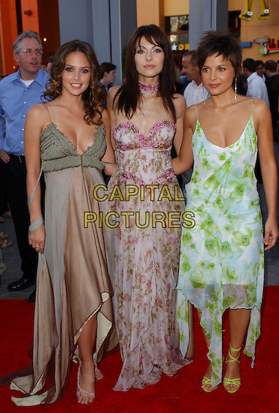 JOSIE MARAN  SILVIA COLLACA & ELENA ANAYA.Attending the world premiere of movie Van Helsing at The Universal City Walk in Universal City, California..May 3rd 2004.full length full-length hugging smilinglong floaty dress boobs low cut plunging neckline.*UK sales only*.www.capitalpictures.com.sales@capitalpictures.com.©Capital Pictures