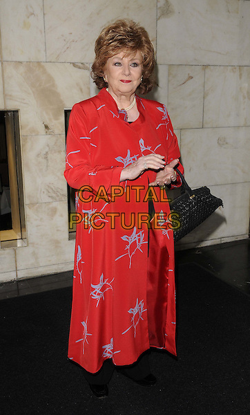 Barbara Knox.The Women Of The Year Lunch, Intercontinental hotel, Park Lane, London, England..October 17th, 2011.full length red print dress blue hands.CAP/CAN.©Can Nguyen/Capital Pictures.