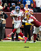 New York Giants running back Saquon Barkley (26) runs past Washington Redskins outside linebacker Ryan Kerrigan (91) after making a reception in the first quarter against the Washington Redskins at FedEx Field in Landover, Maryland on Sunday, December 9, 2018.  The Giants won the game 40 - 16.<br /> Credit: Ron Sachs / CNP<br /> (RESTRICTION: NO New York or New Jersey Newspapers or newspapers within a 75 mile radius of New York City)
