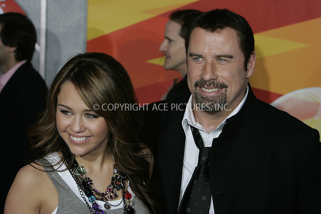 WWW.ACEPIXS.COM . . . . . ....November 17 2008, LA....Actress Miley Cyrus and actor John Travolta arriving at the premiere of 'Bolt' on November 17, 2008 in Hollywood, California.....Please byline: JOE WEST- ACEPIXS.COM.. . . . . . ..Ace Pictures, Inc:  ..(646) 769 0430..e-mail: info@acepixs.com..web: http://www.acepixs.com