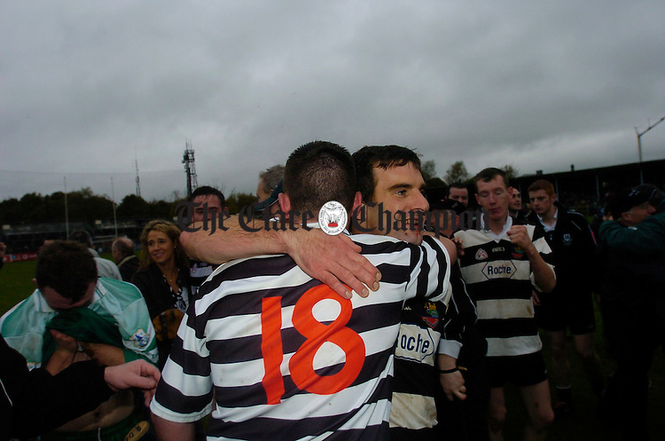 Eric Flynn, right,  is congratulated by team mate Alan O Loughlin after the final whistle. Photograph by John Kelly.