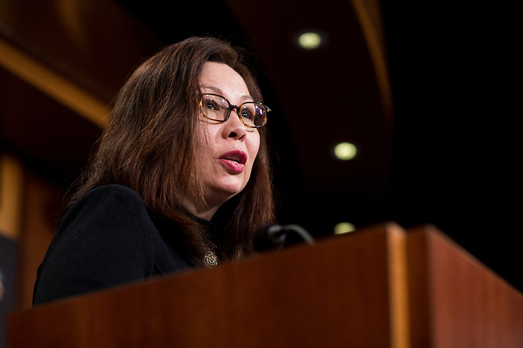 UNITED STATES - MARCH 14: Sen. Tammy Duckworth, D-Ill., speaks during the Senate Democrats' news conference to unveil the FAMILY Act on Tuesday, March 14, 2017. (Photo By Bill Clark/CQ Roll Call)