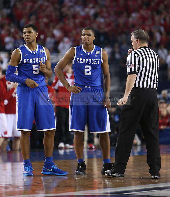 Kentucky Wildcats guard Aaron Harrison (2) and Kentucky Wildcats guard Andrew Harrison (5) talk with the referee during the NCAA Final Four vs. Wisconsin at the AT&T in Arlington, Tx., on Saturday, April 5, 2014. Photo by Emily Wuetcher | Staff