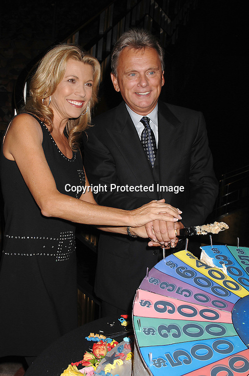 "Vanna White and Pat Sajak eating the cake..at The 25th Anniversary party for ""Wheel of Fortune"" ..on September 27, 2007 at Radio City Music Hall, where they will tape 3  weeks of shows.....photo by Robin Platzer, Twin Images....212-935-0770"