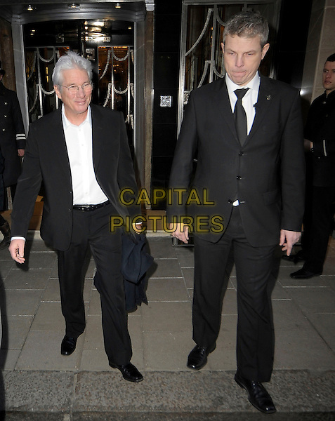 Richard Gere leaving Claridge's Hotel in central London, England..20th February 2013.full length black suit white shirt glasses minder bodyguard.CAP/IA.©Ian Allis/Capital Pictures.