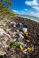 pollution - plastic bottles and other trash, washed up on the beach, Turneffe Atoll, Belize, Caribbean Sea, Atlantic Ocean