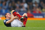 Scott Brown goes down in agony after getting a knock