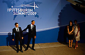 Pittsburgh, PA - September 24, 2009 -- United States President Barack Obama (2L) welcomes French President Nicolas Sarkozy (L) to the welcoming dinner for G-20 leaders as U.S. first lady Michelle Obama (R) and French first lady Carla Sarkozy look on at the Phipps Conservatory on Thursday, September 24, 2009 in Pittsburgh, Pennsylvania. Heads of state from the world's leading economic powers arrived today for the two-day G-20 summit held at the David L. Lawrence Convention Center aimed at promoting economic growth. .Credit: Win McNamee / Pool via CNP