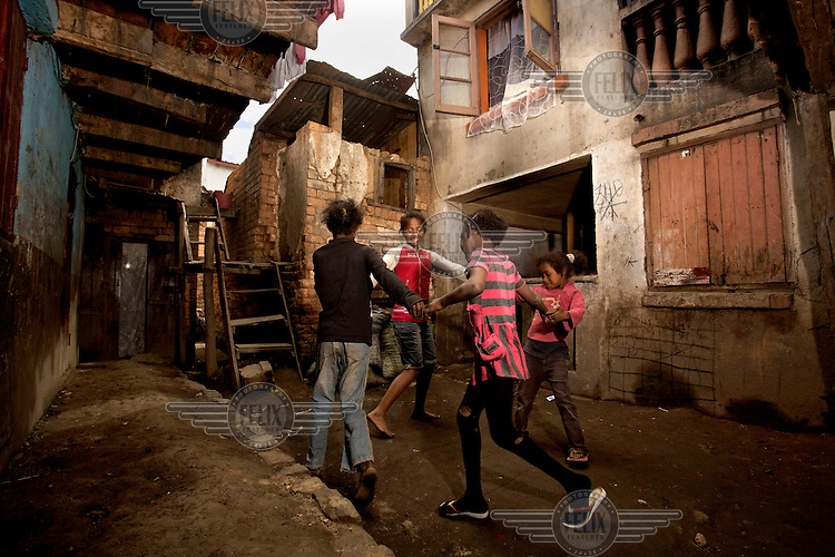 Erika, 14, plays with friends outside her home.