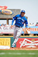 Toronto Blue Jays shortstop Ryan Goins (17) running the bases during a Spring Training game against the Pittsburgh Pirates on March 3, 2016 at McKechnie Field in Bradenton, Florida.  Toronto defeated Pittsburgh 10-8.  (Mike Janes/Four Seam Images)