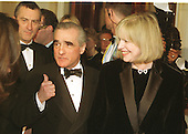 Martin Scorsese, center, seems to gesture towards Robert De Niro, left, in the receiving line at the Millennium celebration at the White House in Washington, D.C. on December 31, 1999.  With Scorsese at right is Helen Scorsese..Credit: Ron Sachs / CNP