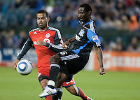 Ike Opara  (right) kicks the ball against Jacob Peterson (left). The San Jose Earthquakes tied Toronto FC 1-1 at Buck Shaw Stadium in Santa Clara, California on April 9th, 2011.